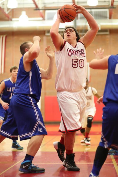 Nick Streubel scored 11 in the fourth to fuel a furious Wolf comeback.