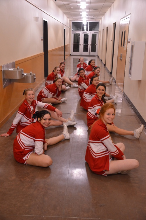Wolf cheerleaders do a little pre-game stretching.