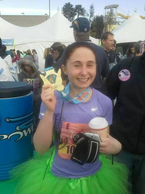 Emily Norris, post-race, with award (and coffee).
