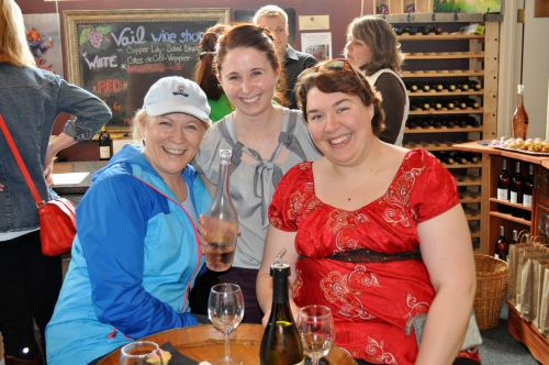 Emily Norris (center), holding court at a cupcake and wine tasting. (Lorene Norris photo)