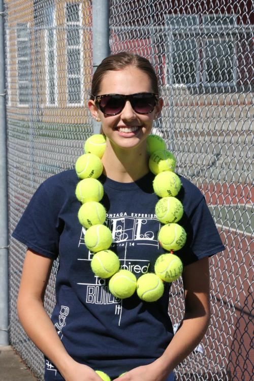 Allie Hanigan sports the necklace awarded to netters who win the Player of the Match, as she did after a win Monday. (JOhn Fisken photos)
