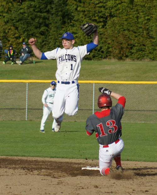 Ricky Muzzy goes airborne as Coupeville's Korbin Korzan slides into the bag. (Shelli Trumbull photo)
