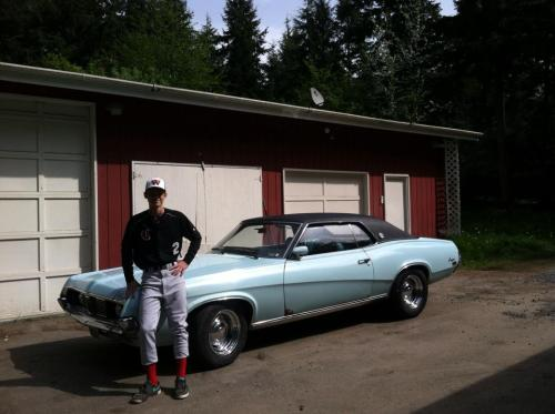Jake Davis with his two loves -- baseball and cars.