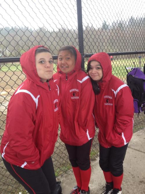 Cedillo (right), braves a rain out during softball season with teammates Emily Coulter (left) and Erin Josue.