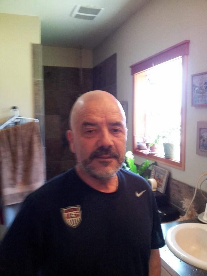 Coach shaved head