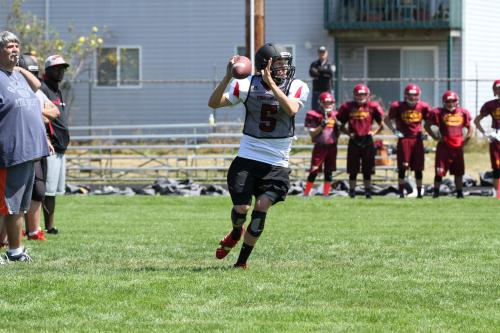 Langvold's successor, Joel Walstad, rolls out to fire a pass.