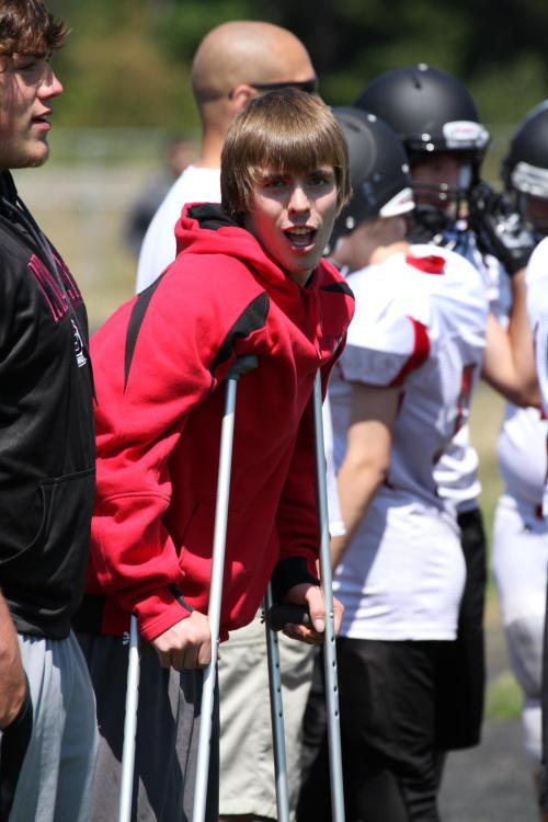 Fomer Wolf QB Gunnar Langvold hangs out on crutches