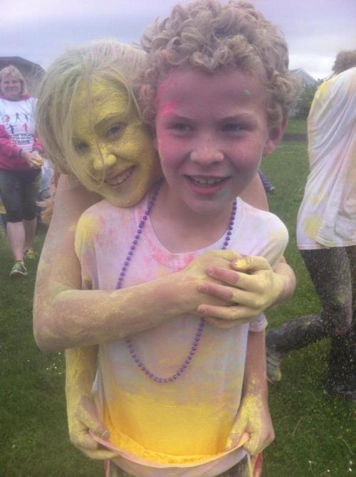 Mckenzie and Caleb Meyer, seen here at an earlier Color Run, show you what's in store for runners Saturday. (Jodi Crimmins photo)
