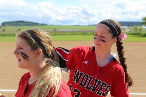 Bailey uses the Million Dollar Arm to check teammate Madeline Roberts'
