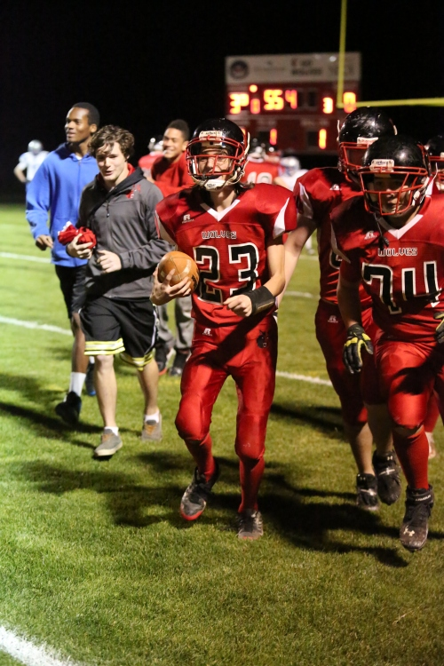 Raymond Beiriger (with ball) comes off the field after scoring against Chimacum. (John Fisken photos)