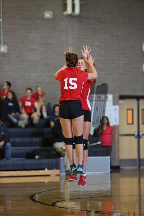 Kalia Littlejohn (15) and Lindsey Roberts celebrate.
