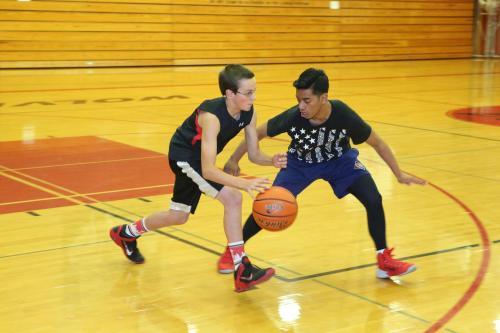 Johnson shadows Wolf freshman Nick Etzell.