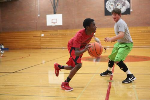 Dante Mitchell drives on James Vidoni during a drill.