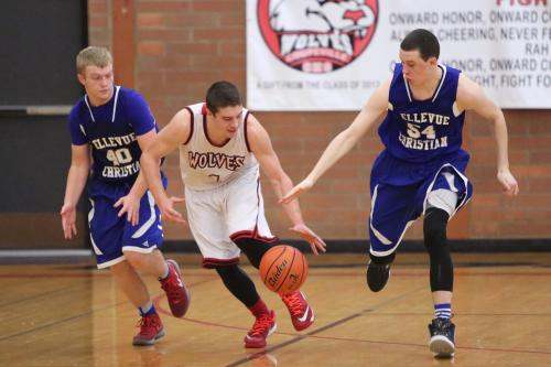Wiley Hesselgrave nimbly keeps the ball away from a pair of defenders.