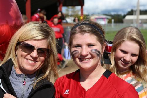 Madelien Roberts (center) during her senior softball season at CHS. (John Fisken photo)