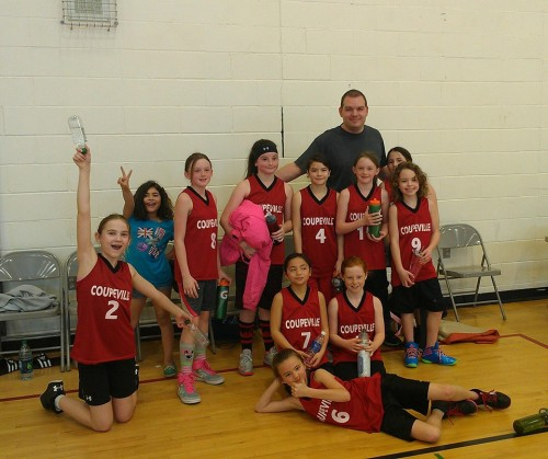 Coupeville's 5th/6th grade squad celebrates with coach Lark Gustafson. (Katy Wells photo)