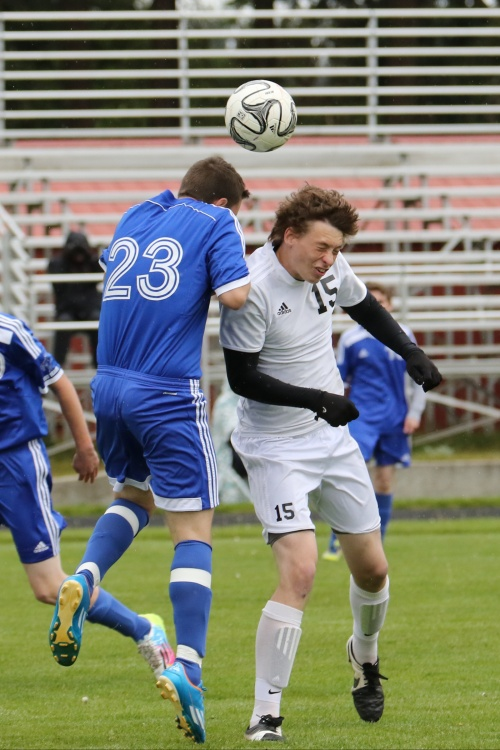 Colin Belliveau (15) drops the boom on a pesky foe. (John Fisken photos)