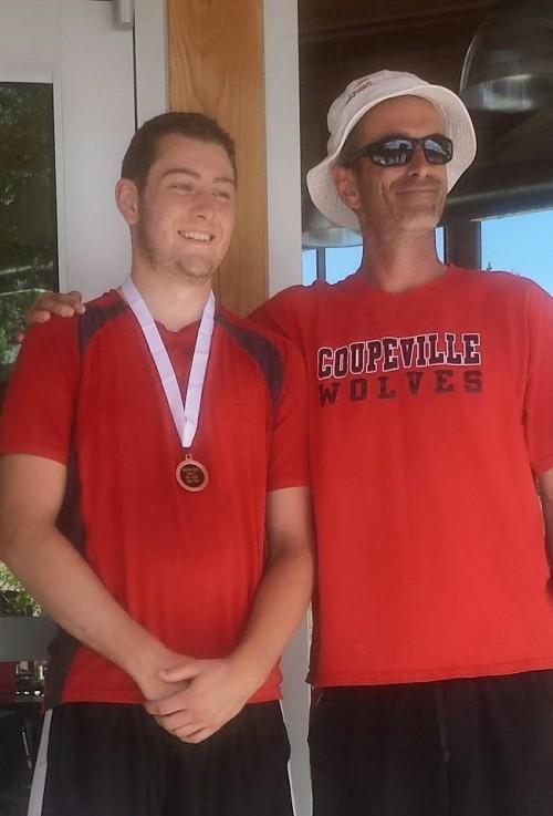 Aaron Curtin (left) poses with proud coach Ken Stange. (Judi Curtin photo)