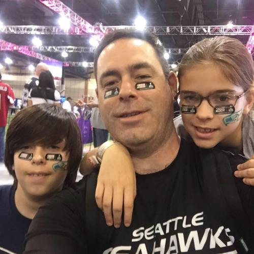Former Wolf great Marc Aparicio with children Katelyn.