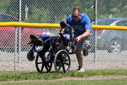 A dad and son team zing around third base and head for home.
