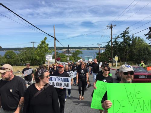 Marchers head up from the water towards the jail.