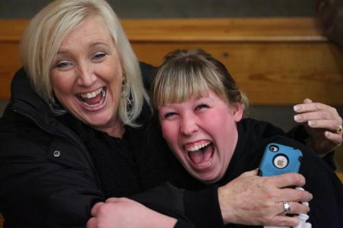 Former CHS cheer coach Sylvia Arnold (left) shares a moment with Sydney Autio (john Fisken photos)