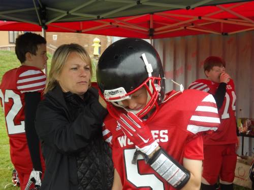 Angie Downes gets her middle son, Sage, ready to play.
