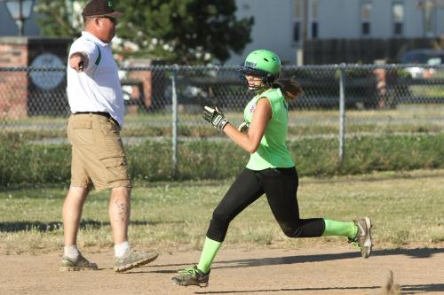 Kevin McGranahan, seen here coaching daughter Katrina in little league play, was tabbed as the new CHS head softball coach. (John Fisken photo)