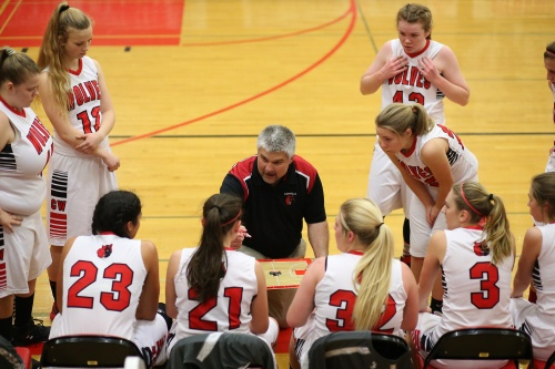 David King lays down some wisdom to his high-flying Wolf girls squad. (John Fisken photos)