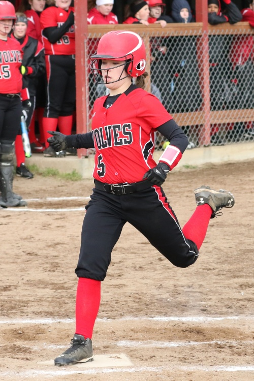 Lauren Rose stamps on home for one of the 33 runs scored Wednesday. (John Fisken photo)
