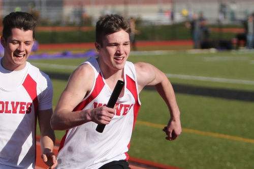 Jacob Martin (right) takes the hand-off from Gabe Eck and sprints away in the 4 x 100.