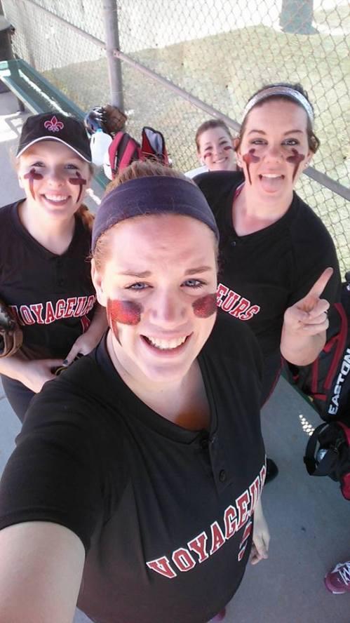 Wolf grad Monica Vidoni (center) smacked her second college home run Wednesday in Minnesota.