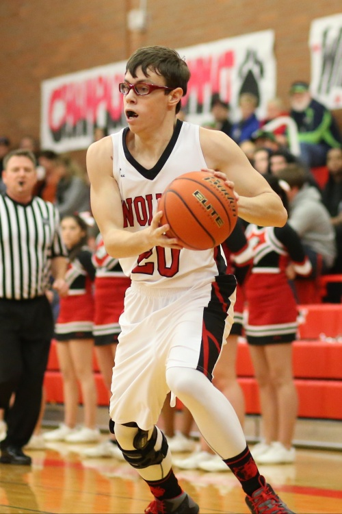 Jared Helmstadter goes strong to the hoop.