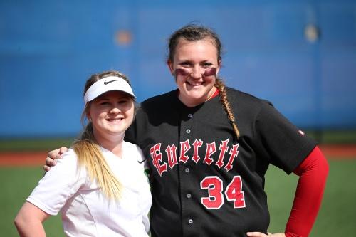 Madeline Roberts (left) and Hailey Hammer, reunited on the college softball diamond. (John Fisken photo)