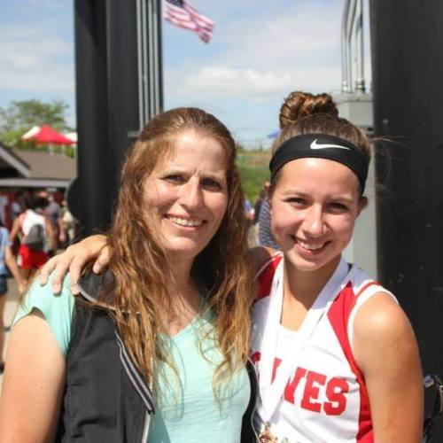 Sylvia Hurlburt, seen here with mom Kristin on a sunnier day than Saturday was, won three races Saturday and qualified for districts in a fourth.