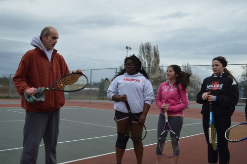 Borges and teammates Jazmine Franklin (left) and McKenzie Bailey listen to Wolf tennis coach Ken Stange during an early practice.