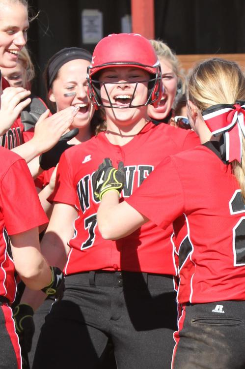 Madeline Strasburg and Co. celebrate a home-run in this vintage shot. (John Fisken photos)