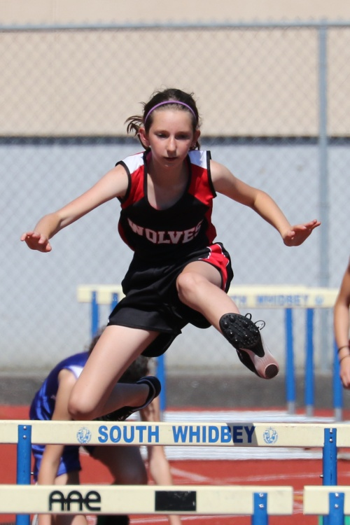 Megan Thorn flies over the hurdles as a 7th grader at CMS. (John Fisken photos)