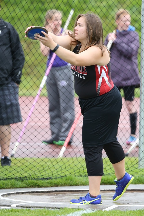 Junior thrower Alexxis Otto was one of 28 Wolf track stars to letter this season. (John Fisken photos)