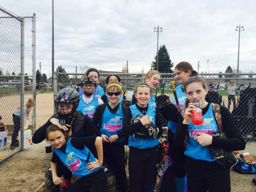 Age 14 or under and love softball? You could soon be in this picture. (Photo courtesy Mimi Johnson)