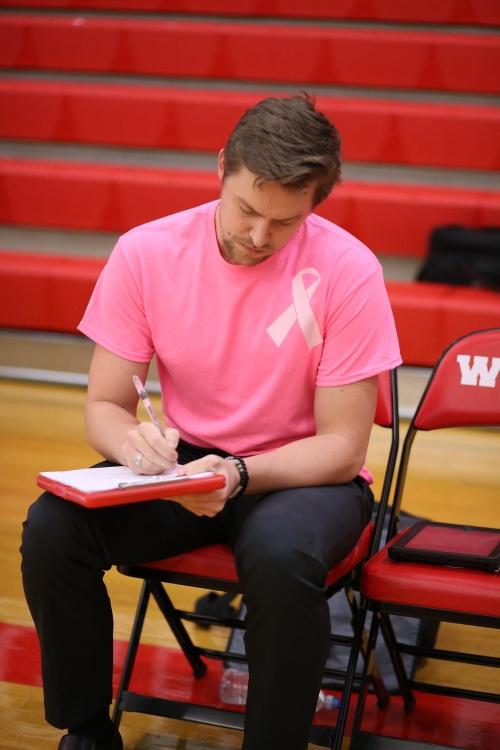 First-year CHS volleyball coach Cory Whitmore has guided the Wolf spikers to their first league title since 2004. (John Fisken photo)