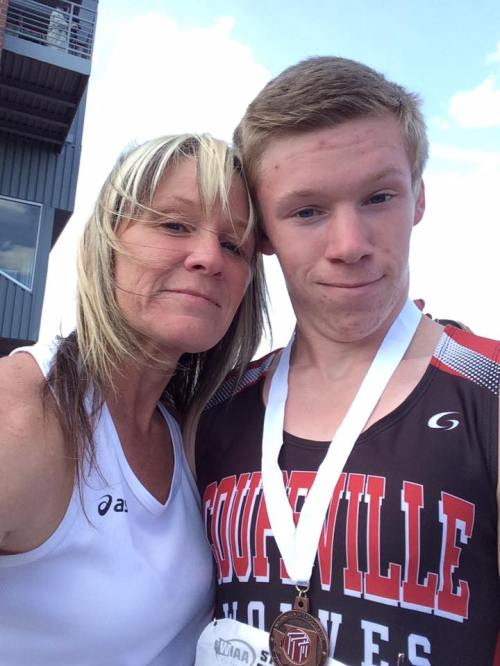 Deb Smith, seen here with son Jacob at the state track meet last spring, is leading a drive to help Coupeville's homeless.