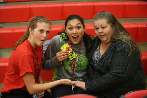 Makana Stone (center), seen here back in the day with Lindsey Roberts (left) and Amy Briscoe, had another string college hoops game Saturday. (John Fisken photo)