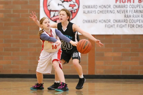 Lily Leedy makes the pass before the Sequim defender completely chomps her head.