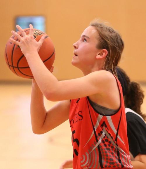 Izzy Wells, seen here during a SWISH game, scored six points in her middle school hoops debut. (John Fisken photo)