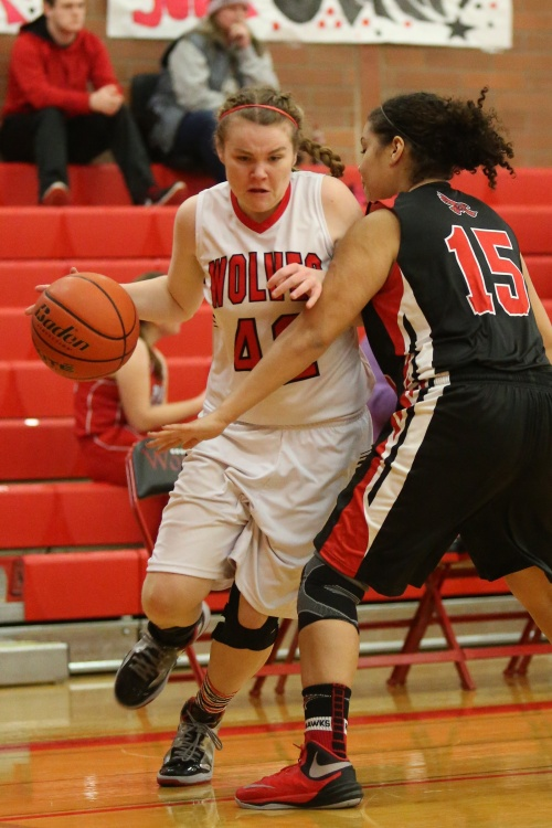 Kailey Kellner busts through the defense, on her way to rattling home another bucket. (John Fisken photos)